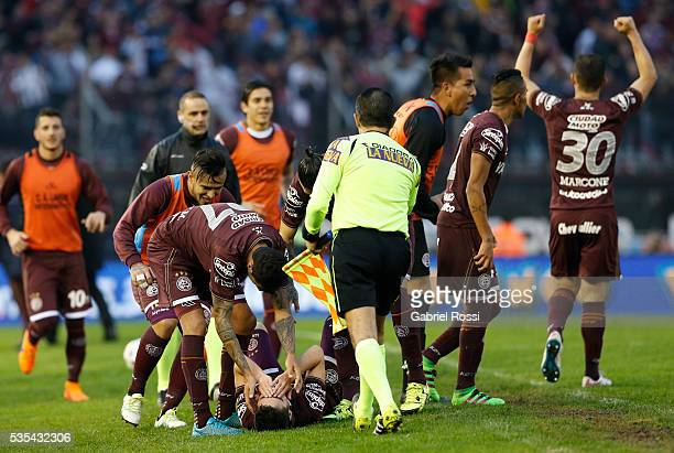 Miguel Almiron of Lanus celebrates with teammates after scoring the second goal of his team during a final match between San Lorenzo and Lanus as...