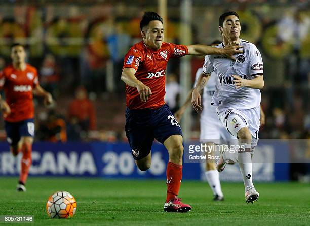 Miguel Almiron of Lanus is fouled by Gustavo Toledo of Independiente during a match between Independiente and Lanus as part of Copa Sudamericana 2016...