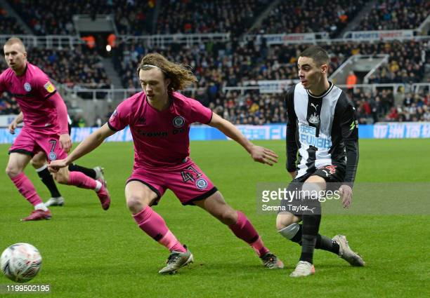 Miguel Almiron of Newcastle United and Luke Matheson of Rochdale in action during the FA Cup Third Round Replay match between Newcastle United and...