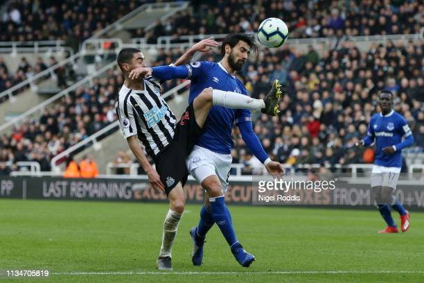 Miguel Almiron of Newcastle United battles for possession with Andre Gomes of Everton during the Premier League match between Newcastle United and...