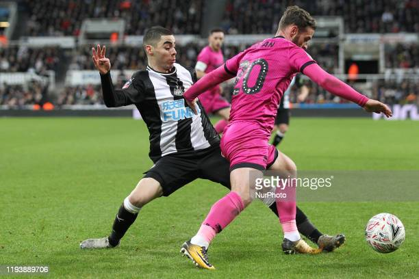 Miguel Almiron of Newcastle United battles for possession with Jimmy Ryan of Rochdale during the FA Cup match between Newcastle United and Rochdale...