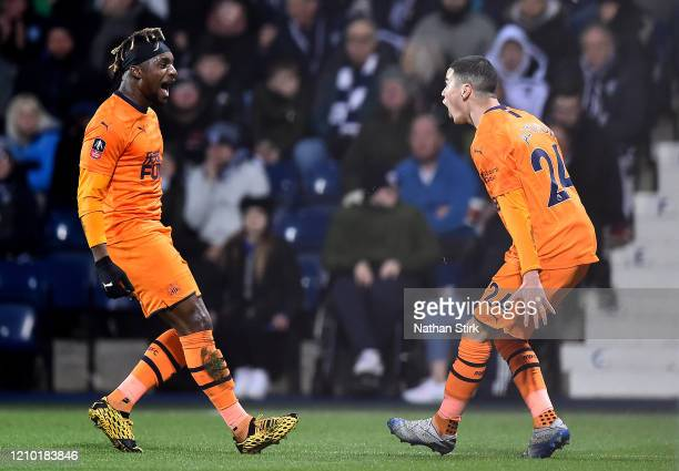 Miguel Almiron of Newcastle United celebrates scoring his sides first goal with Allan Saint-Maximin during the FA Cup Fifth Round match between West...