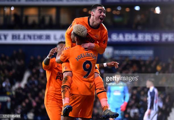Miguel Almiron of Newcastle United celebrates scoring his sides second goal with Joelinton during the FA Cup Fifth Round match between West Bromwich...