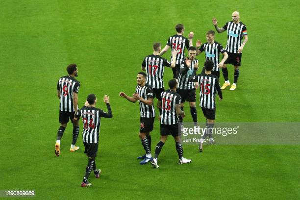 Miguel Almiron of Newcastle United celebrates with teammate Isaac Hayden of Newcastle United after scoring his team's first goal during the Premier...