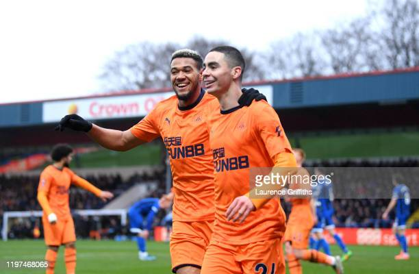 Miguel Almiron of Newcastle United celebrates with teammate Joelinton after scoring his team's first goal during the FA Cup Third Round match between...