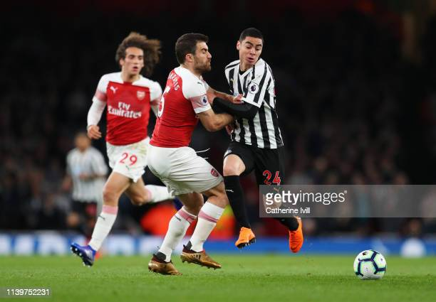 Miguel Almiron of Newcastle United is cahllenged by Sokratis Papastathopoulos of Arsenal during the Premier League match between Arsenal FC and...