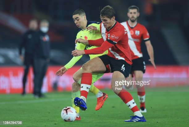 Miguel Almiron of Newcastle United is challenged by Jannik Vestergaard of Southampton during the Premier League match between Southampton and...