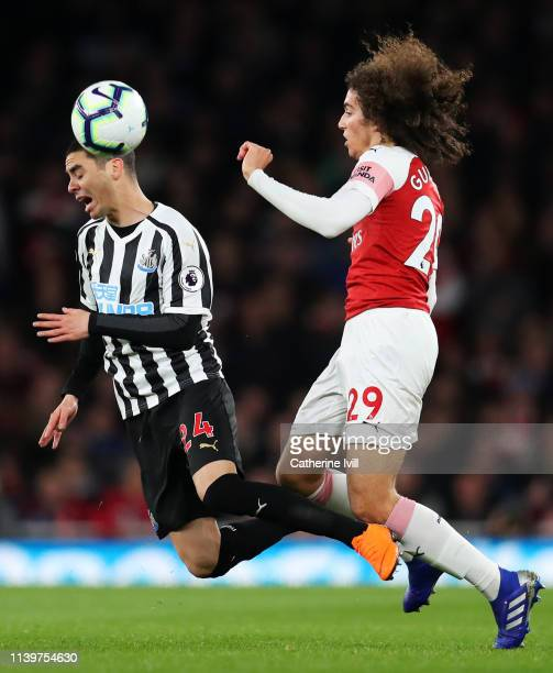 Miguel Almiron of Newcastle United is challenged by Matteo Guendouzi of Arsenal during the Premier League match between Arsenal FC and Newcastle...