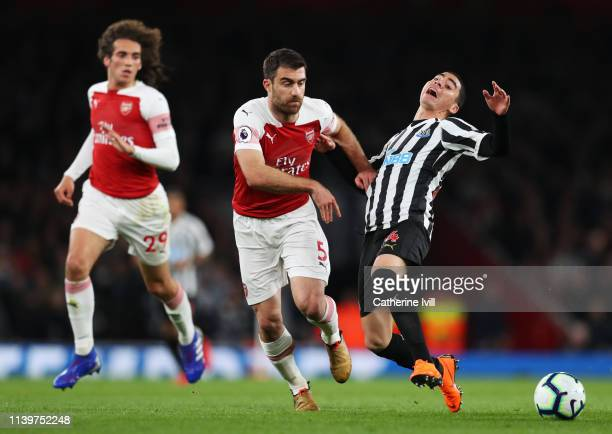 Miguel Almiron of Newcastle United is challenged by Sokratis Papastathopoulos of Arsenal during the Premier League match between Arsenal FC and...