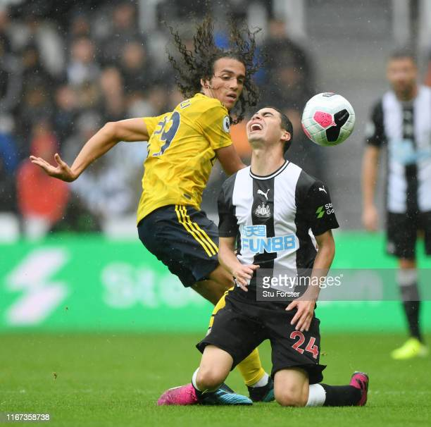 Miguel Almiron of Newcastle United reacts after being tackled by Matteo Guendouzi of Arsenal during the Premier League match between Newcastle United...