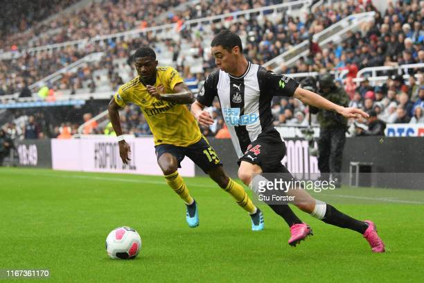 Miguel Almiron of Newcastle United runs past Ainsley MaitlandNiles of Arsenal during the Premier League match between Newcastle United and Arsenal FC...