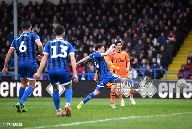 Miguel Almiron of Newcastle United scores his team's first goal during the FA Cup Third Round match between Rochdale AFC and Newcastle United at...