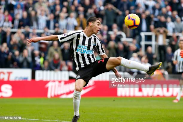 Miguel Almiron of Newcastle United stretches for the ball during the Premier League match between Newcastle United and Huddersfield Town at St James...