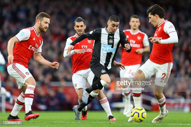 Miguel Almiron of Newcastle United takes on Hector Bellerin of Arsenal during the Premier League match between Arsenal FC and Newcastle United at...