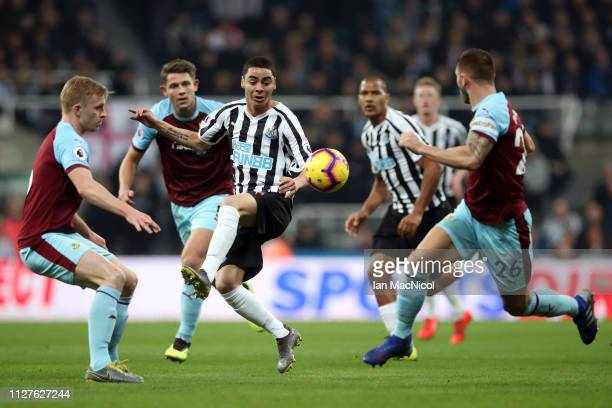 Miguel Almiron of Newcastle United takes on the Burnley defence during the Premier League match between Newcastle United and Burnley FC at St James...