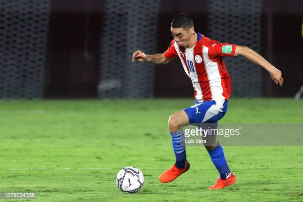 Miguel Almiron of Paraguay drives the ball during a match between Paraguay and Peru as part of South American Qualifiers for Qatar 2022 at Estadio...