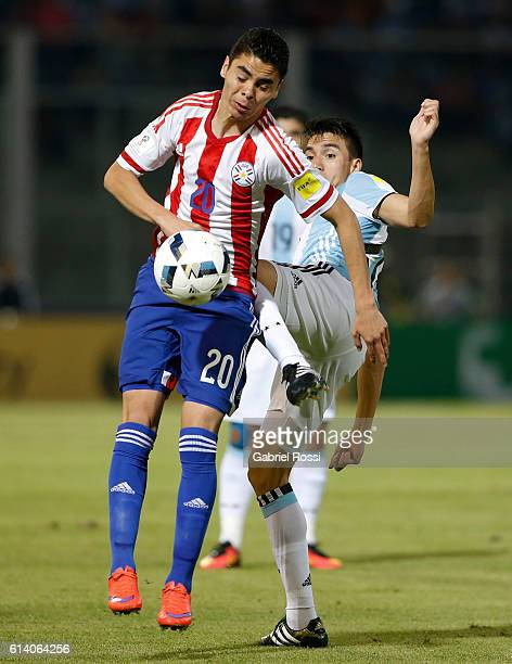 Miguel Almiron of Paraguay fights for the ball with Nicolas Gaitan of Argentina during a match between Argentina and Paraguay as part of FIFA 2018...