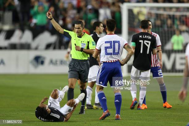 Miguel Almiron of Paraguay receives a red card during the friendly match between Paraguay and Mexico at Levi's Stadium on March 26 2019 in Santa...