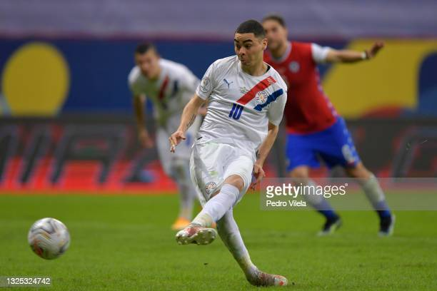Miguel Almiron of Paraguay takes a penalty kick to score the second goal of his team during a Group A match between Chile and Paraguay as part of...