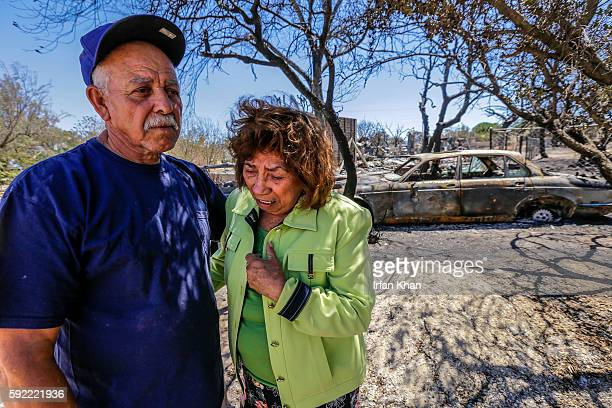 Miguel and Mabel Ramos both 73yearold are distraught by the devastation caused by Blue Cut Fire that swept through his residence on 6500 block of Oak...