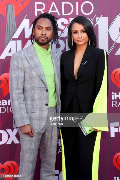 Miguel and Nazanin Mandi attend the 2019 iHeartRadio Music Awards which broadcasted live on FOX at Microsoft Theater on March 14 2019 in Los Angeles...