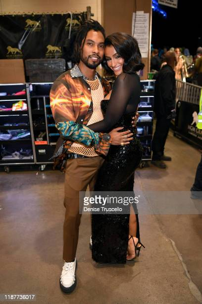 Miguel and Nazanin Mandi backstage during the 20th annual Latin GRAMMY Awards at MGM Grand Garden Arena on November 14 2019 in Las Vegas Nevada