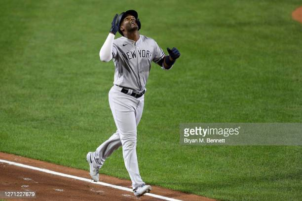 Miguel Andujar of the New York Yankees celebrates after hitting a one run home run during the fourth inning against the Toronto Blue Jays at Sahlen...