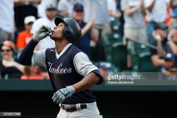 Miguel Andujar of the New York Yankees celebrates after hitting a three-run home run in the third inning against the Baltimore Orioles during game...