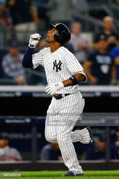 Miguel Andujar of the New York Yankees celebrates after hitting a solo home run in the second inning against the Boston Red Sox at Yankee Stadium on...