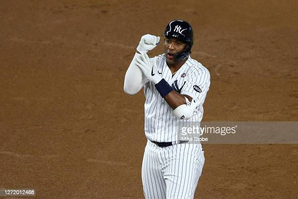 Miguel Andujar of the New York Yankees celebrates after hitting a 2-run double in the first inning Baltimore Orioles at Yankee Stadium on September...