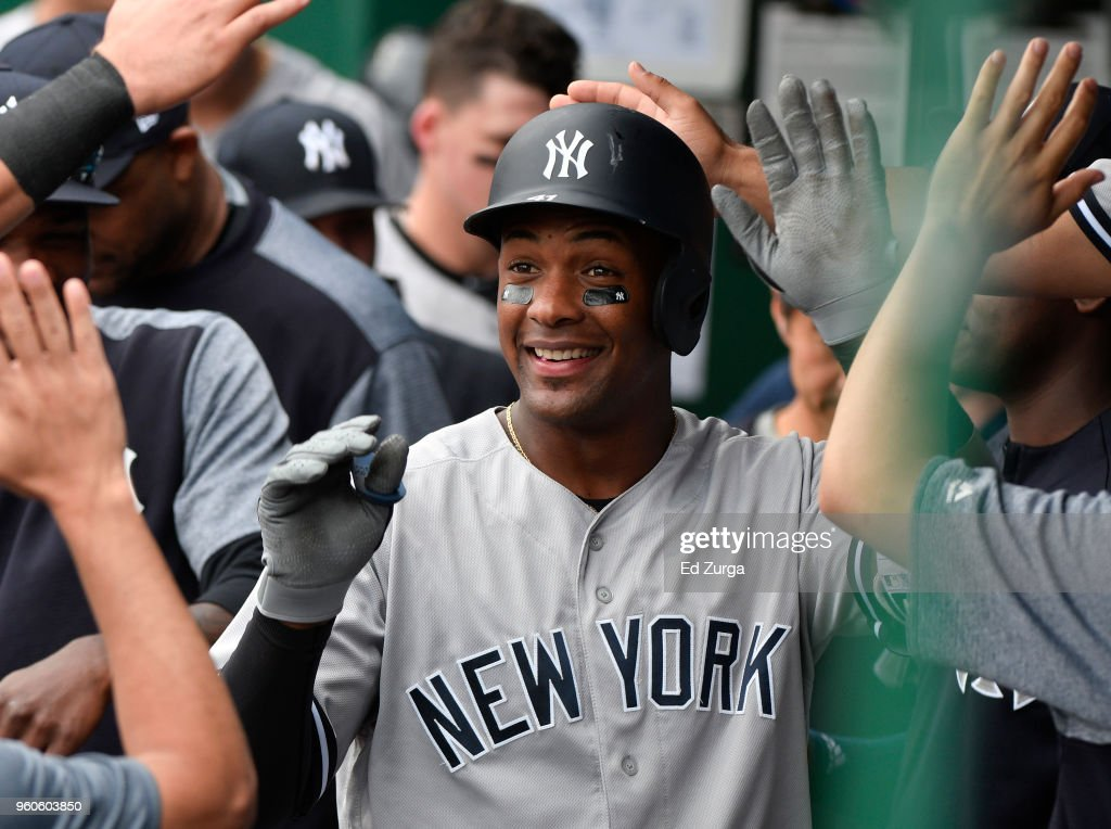Miguel Andujar #41 of the New York Yankees celebrates his home run in the ninth inning against the Kansas City Royals at Kauffman Stadium on May 20, 2018 in Kansas City, Missouri.