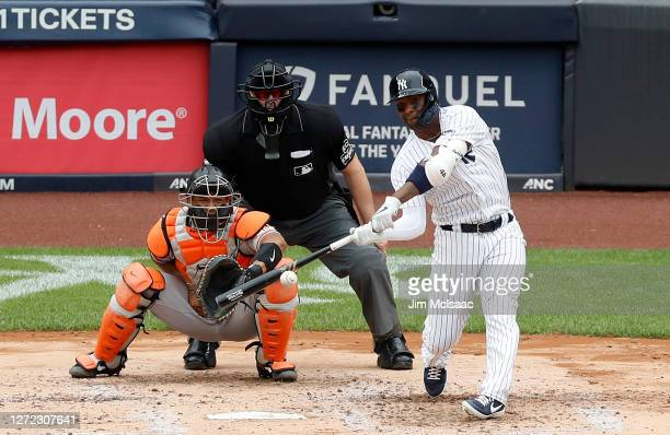 Miguel Andujar of the New York Yankees connects on a fourth inning base hit against the Baltimore Orioles at Yankee Stadium on September 13, 2020 in...