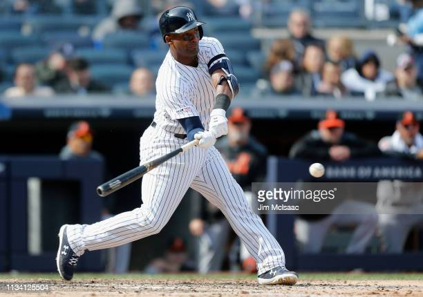 Miguel Andujar of the New York Yankees connects on a seventh inning single against the Baltimore Orioles on Opening Day at Yankee Stadium on March...