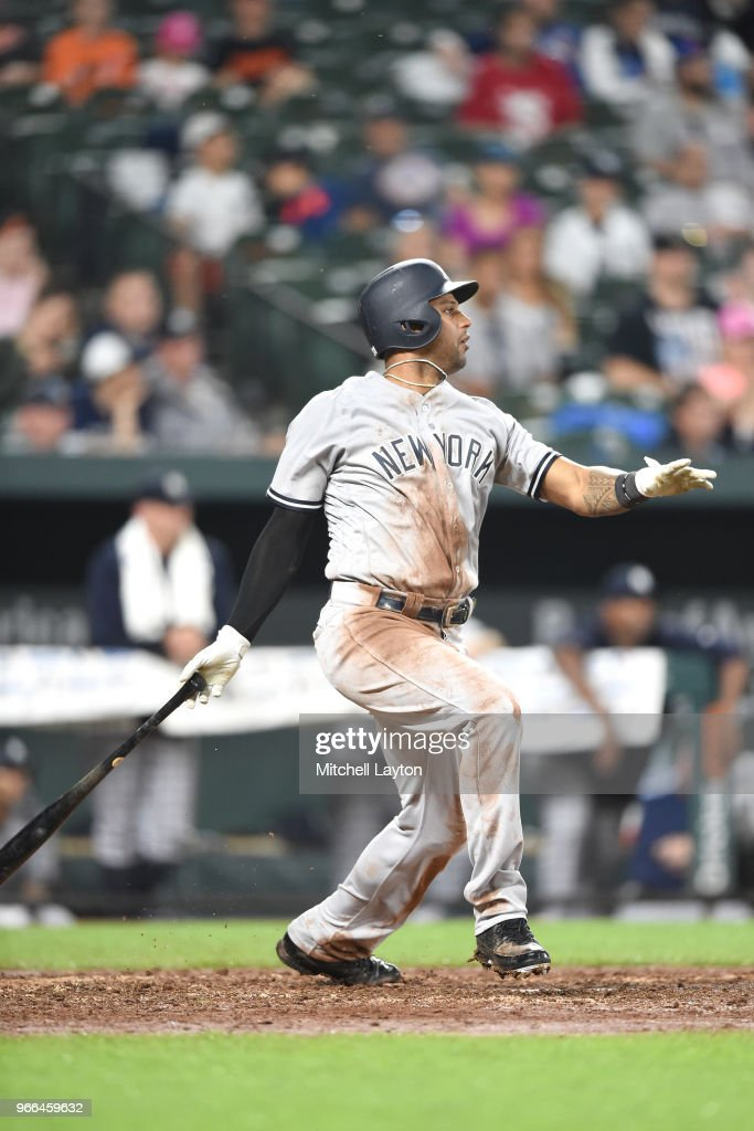 Miguel Andujar #41 of the New York Yankees doubles and scores Aaron Hicks #31 (not pictured) during a baseball game against the Baltimore Orioles at Oriole Park at Camden Yards on June 2, 2018 in Baltimore, Maryland.