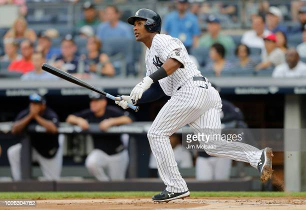 Miguel Andujar of the New York Yankees doubles in the first inning against the Detroit Tigers at Yankee Stadium on September 2 2018 in the Bronx...