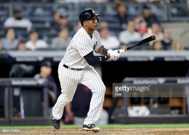Miguel Andujar of the New York Yankees drives in the game winning run in the bottom of the ninth inning against the Cleveland Indians at Yankee...
