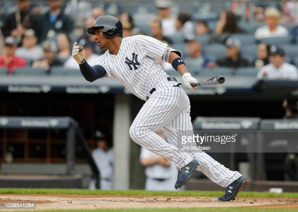 Miguel Andujar of the New York Yankees follows through on a first inning RBI single against the Baltimore Orioles at Yankee Stadium on September 23,...
