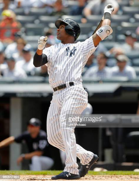 Miguel Andujar of the New York Yankees follows through on a first inning two run home run against the Seattle Mariners at Yankee Stadium on June 21...