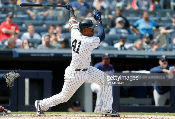 Miguel Andujar of the New York Yankees follows through on a sixth inning single against the Minnesota Twins at Yankee Stadium on May 04, 2019 in the...