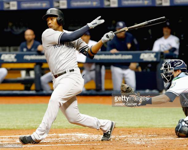 Miguel Andujar of the New York Yankees follows through on his swing after breaking his bat during the second inning of the game against the Tampa Bay...