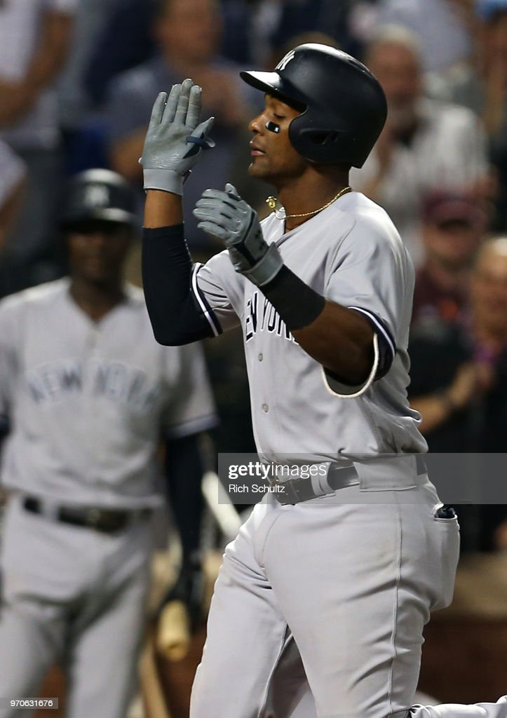 Miguel Andujar #41 of the New York Yankees gestures after he hit a two-run home run against the New York Mets during the sixth inning of a game at Citi Field on June 9, 2018 in the Flushing neighborhood of the Queens borough of New York City.