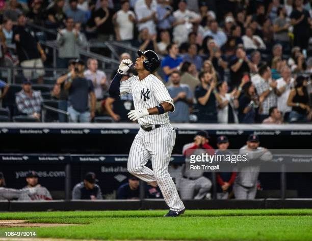 Miguel Andujar of the New York Yankees gestures to the sky after hitting a home run during a game against the Boston Red Sox at Yankee Stadium on...