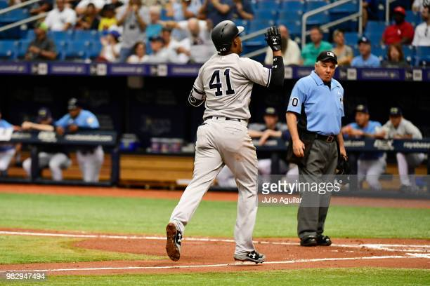 Miguel Andujar of the New York Yankees heads home on his threerun home run in the third inning against the Tampa Bay Rays on June 24 2018 at...