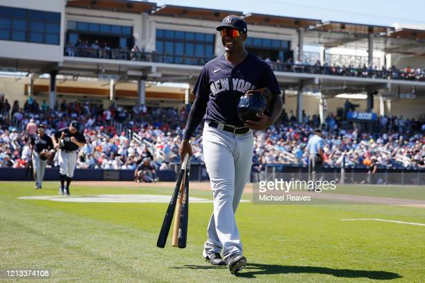 Miguel Andujar of the New York Yankees heads to the clubhouse against the Washington Nationals at the end of the fifth inning of a Grapefruit League...