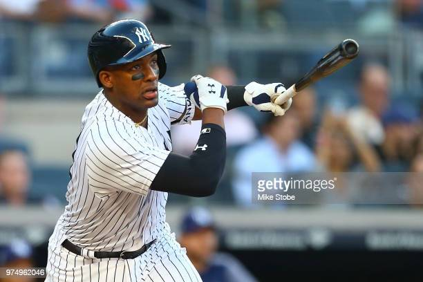 Miguel Andujar of the New York Yankees hits a double in the second inning against the Tampa Bay Rays at Yankee Stadium on June 14 2018 in the Bronx...