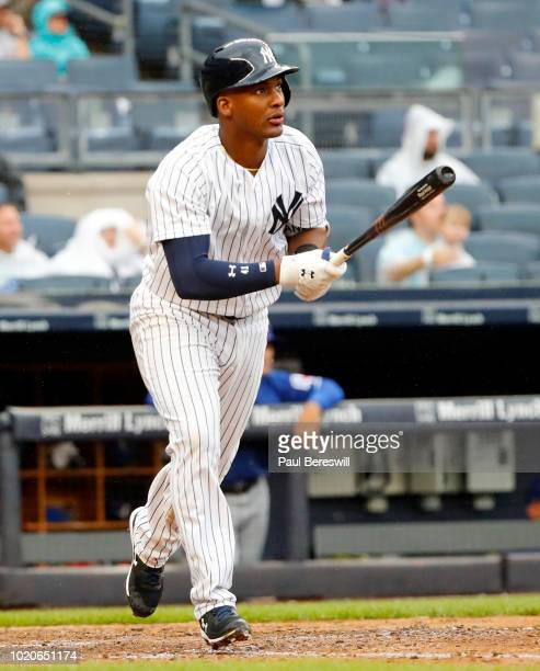Miguel Andujar of the New York Yankees hits a home run during an MLB baseball game against the Texas Rangers on August 11 2018 at Yankee Stadium in...