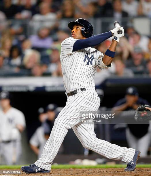 Miguel Andujar of the New York Yankees hits a home run in an MLB baseball game against the Boston Red Sox on September 19 2018 at Yankee Stadium in...