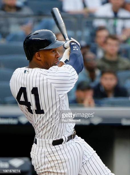 Miguel Andujar of the New York Yankees hits a line drive in an MLB baseball game against the Baltimore Orioles on September 23, 2018 at Yankee...