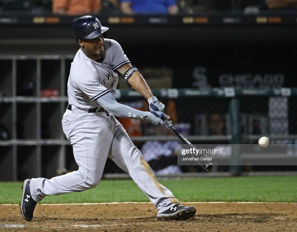 Miguel Andujar #41 of the New York Yankees hits a run scoring single in the 13th inning against the Chicago White Sox at Guaranteed Rate Field on August 7, 2018 in Chicago, Illinois. The Yankees defeated the White Sox 4-3 in 13 innings.