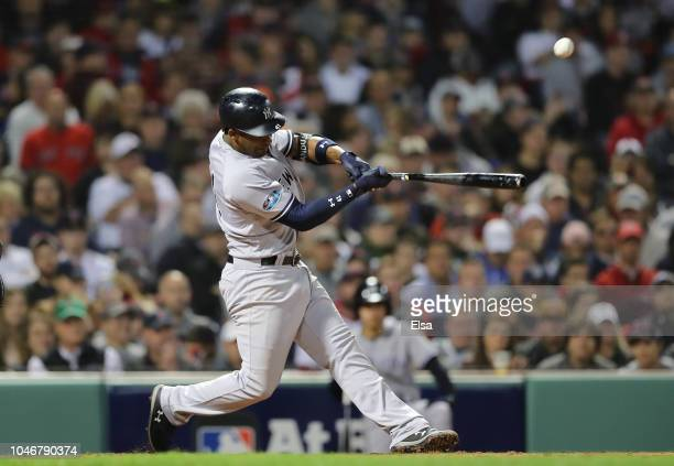 Miguel Andujar of the New York Yankees hits a single during the sixth inning o fGame Two of the American League Division Series against the Boston...
